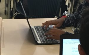 Student's hands on keyboard