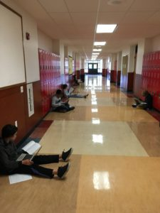 Students recording in hallway